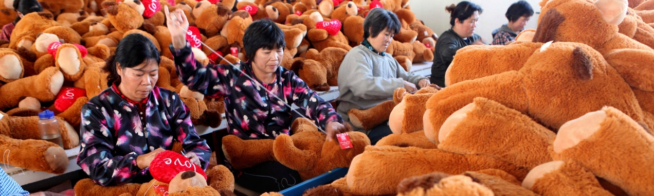 Workers make stuffed animals to be exported to Europe and America at a toy factory in Ganyu county, Zhejiang province November 6, 2013. A stronger-than-expected rebound in China's exports in October added to a run of indicators suggesting the world's second-largest economy has found its footing just as Beijing prepares to lay out its reform agenda for the next decade. Picture taken November 6, 2013. REUTERS/China Daily (CHINA - Tags: BUSINESS EMPLOYMENT SOCIETY) CHINA OUT. NO COMMERCIAL OR EDITORIAL SALES IN CHINA - RTX1553E